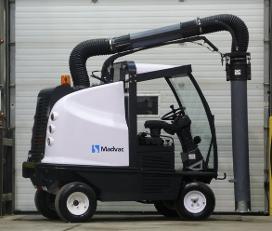 Madvac litter vacuum is in front of industrial garage door